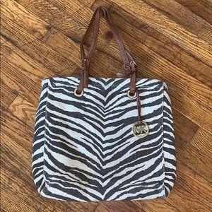 75038fc60927 Women Michael Kors Animal Print Handbag on Poshmark